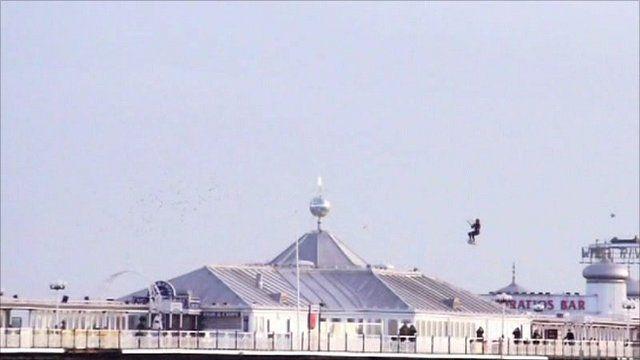 Kite surfer jumping Brighton Pier