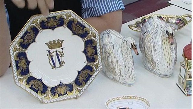 Plate showing intertwined initials and ceramic swans, designed to commemorate Royal engagement