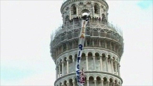 Protesters occupy the Leaning Tower of Pisa