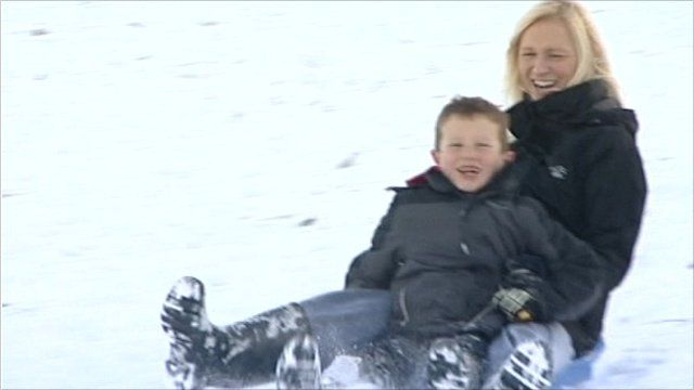 Woman and child sledging