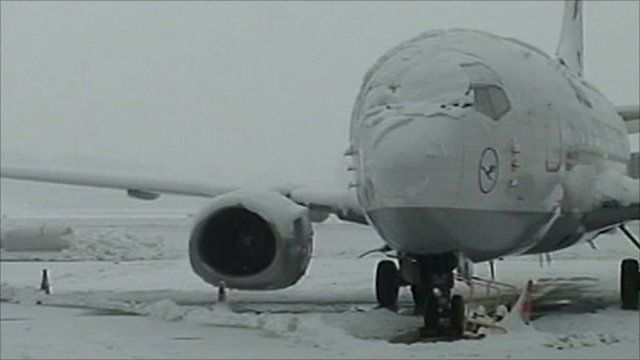 Snow-covered plane at Geneva airport