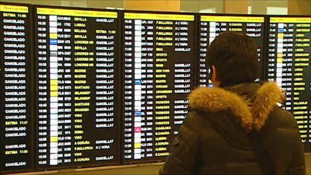Passenger looking at information board