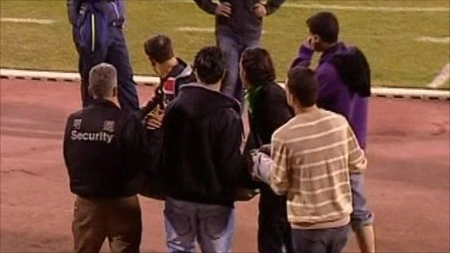 Fans and security officials help injured fans
