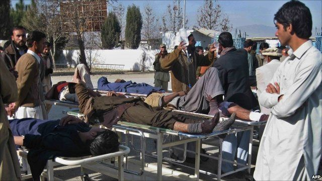 Paramedics treat the injured after a suicide bombing in Khar, north-west Pakistan