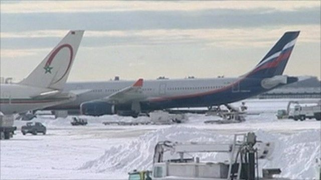 Aeroplanes snowed in at New York's JFK airport
