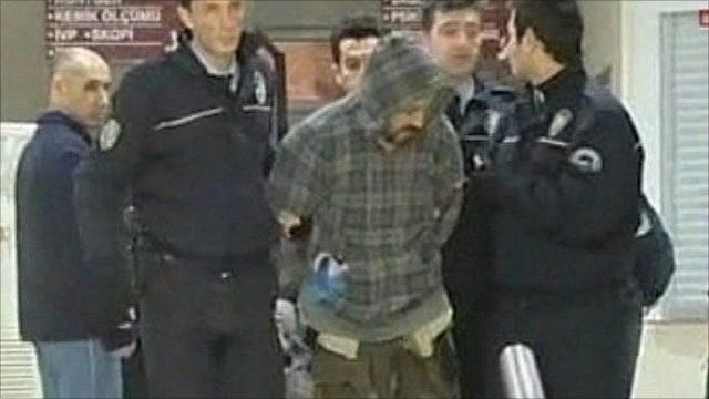 The suspect being lead away by police