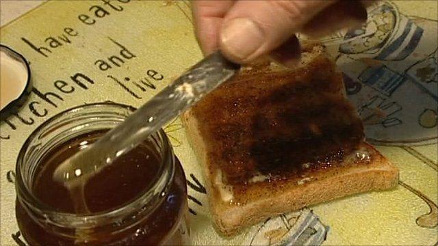 Honey being spread on toast