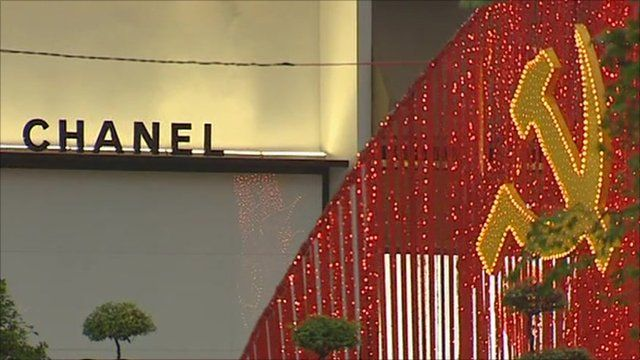 Vietnamese flag in lights next to Chanel sign