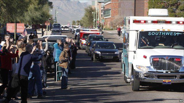Well-wishers waving at the ambulance