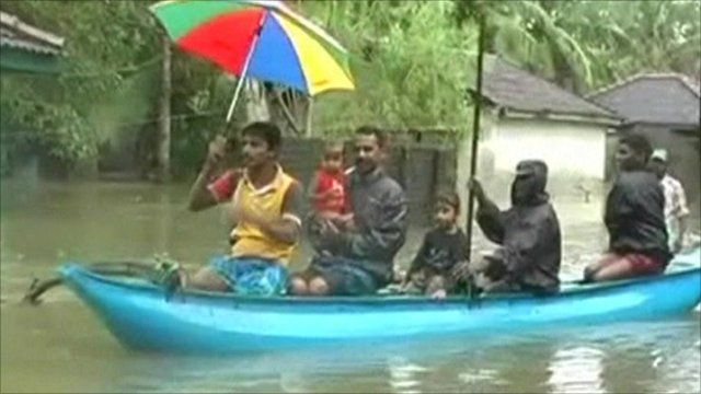 People escaping flooding by boat