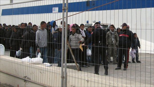 Would-be migrants believed to be from Tunisia are gathered at the port of the Sicilian island of Lampedusa, Italy