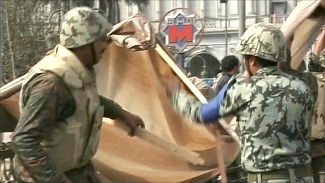 Army taking down a shelter in Tahrir Square, Cairo