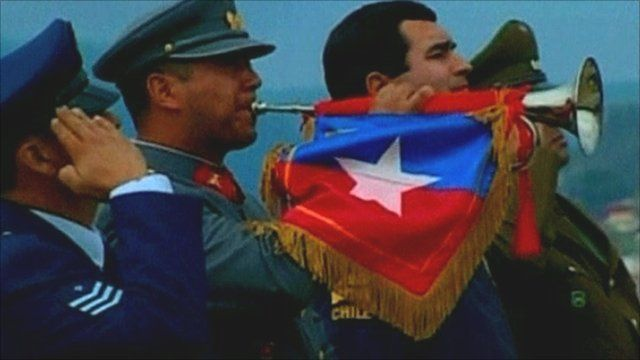 Bugle player at memorial service in Chile