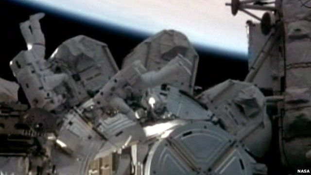 Astronauts Stephen Bowen and Alvin Drew exiting the ISS