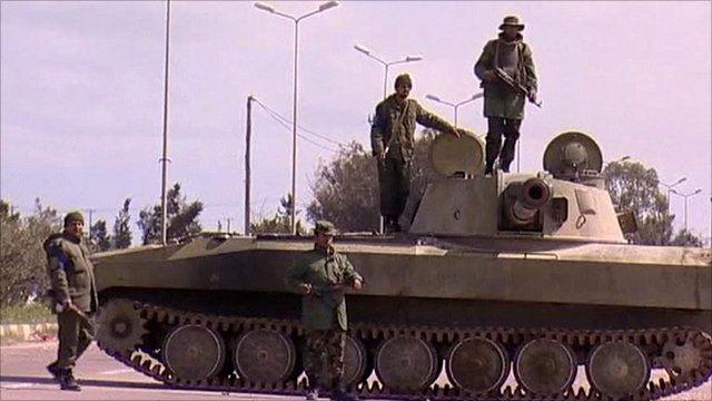 Armed men outside the Libyan city Zawiya