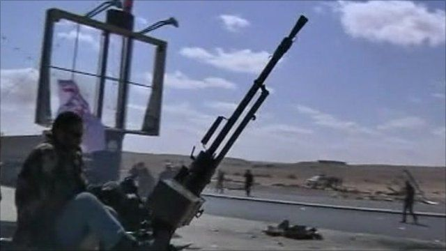 An armed vehicle beside a highway in Libya