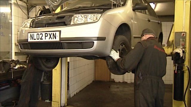 Mechanics working on a car