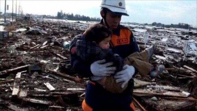 Man rescuing baby