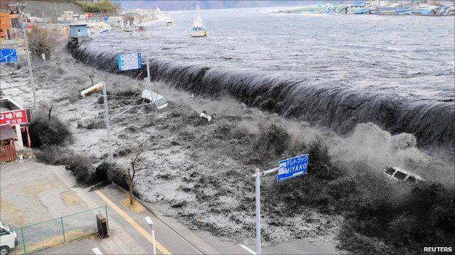 Japan earthquake: Footage of moment tsunami hit - BBC News