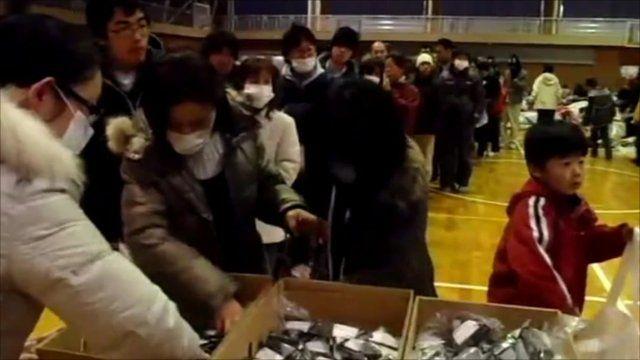 People collecting food at Fukushima High School