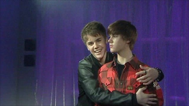 Justin Bieber with his wax figure at at Madame Tussauds in London