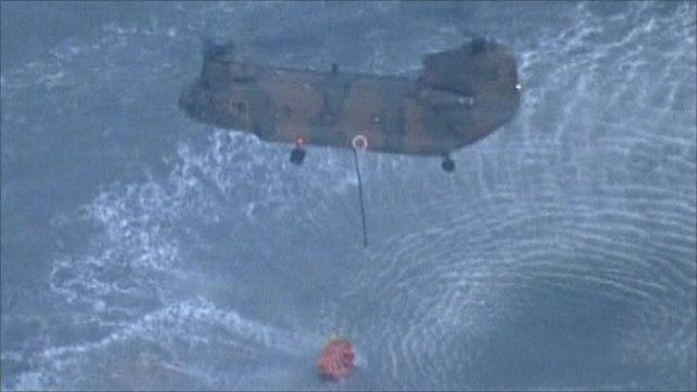 Helicopter picking up water from the sea