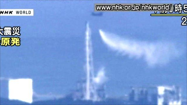 Helicopter drops water on nuclear reactor
