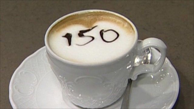 Cup of cappuccino with 150 written into the froth
