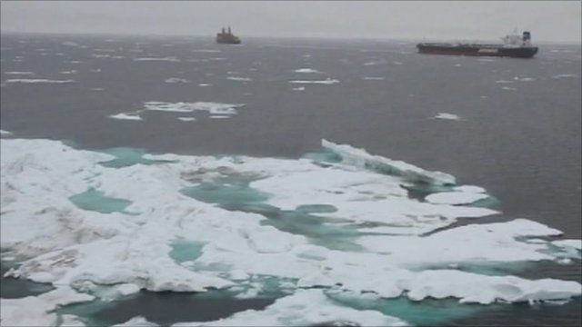 Icebergs and boats in the sea