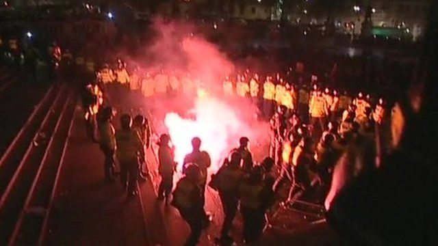 Police and protesters clash in Trafalgar Square