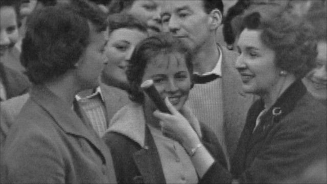 Jean Metcalfe talks to people outside Clarence House