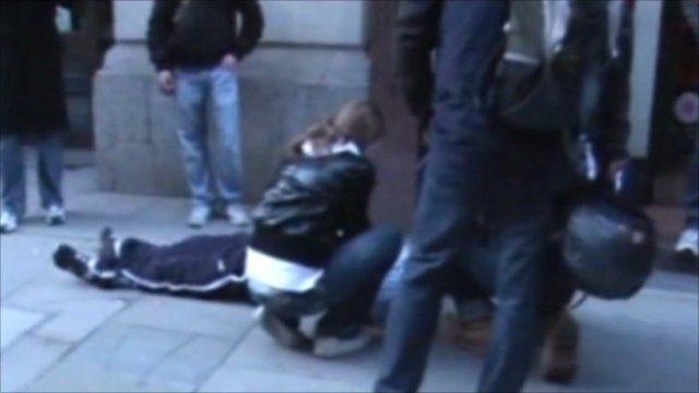 Ian Tomlinson on ground