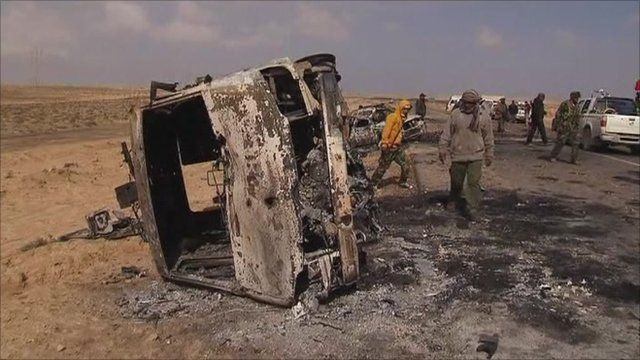 Burned out vehicles ten miles outside Ajdabiya