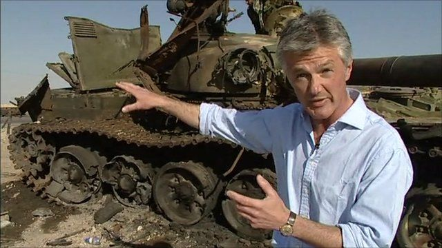Tim Willcox with destroyed tank