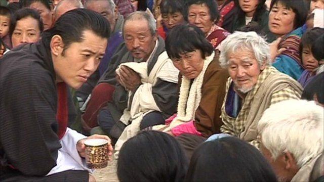 The King of Bhutan listening to a group of people