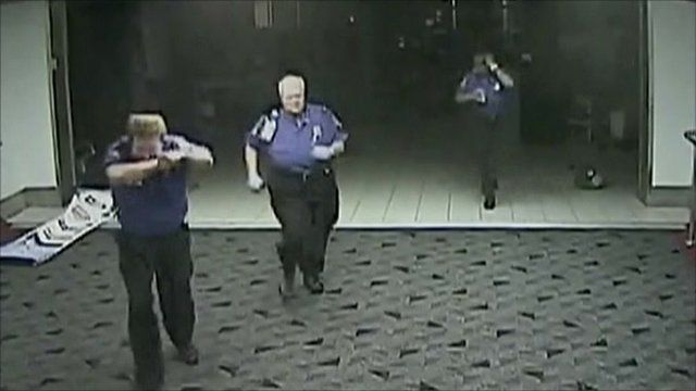 CCTV shows security running for cover