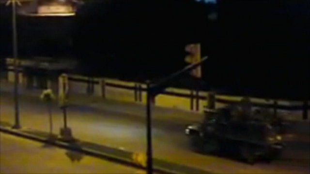 Amateur footage which cannot be verified by the BBC claims to show Syrian troops moving into Homs