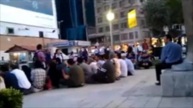 Still from video showing protest in Damascus
