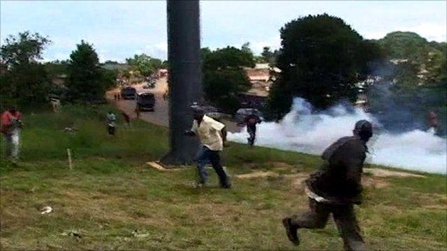 People fleeing tear gas