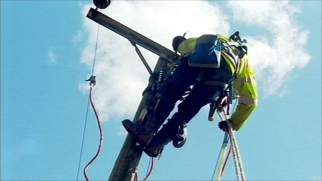 Engineer fixing power cables