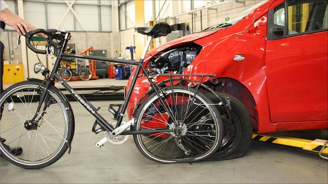 Professor Donal McNally's bike and the car that hit it. Photo: Nottinghamshire Police
