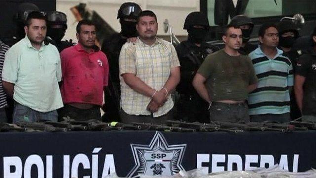 Police parade suspected drug gang members
