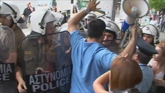 Police and protesters in Greece
