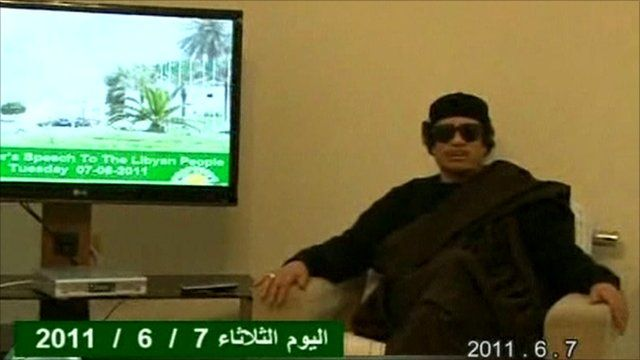 Pictures of Colonel Gaddafi broadcast on Libyan state television