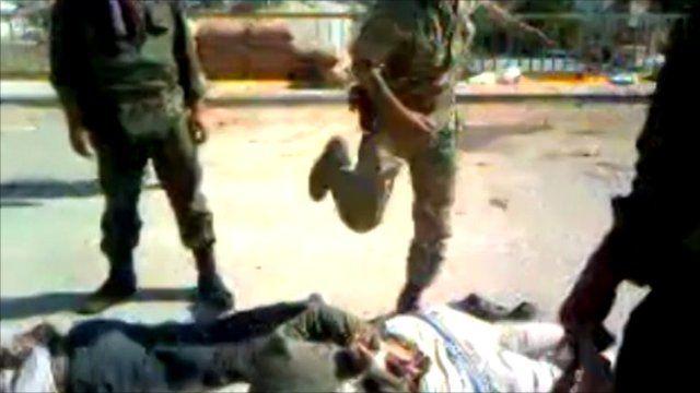 Soldier kicking prisoner