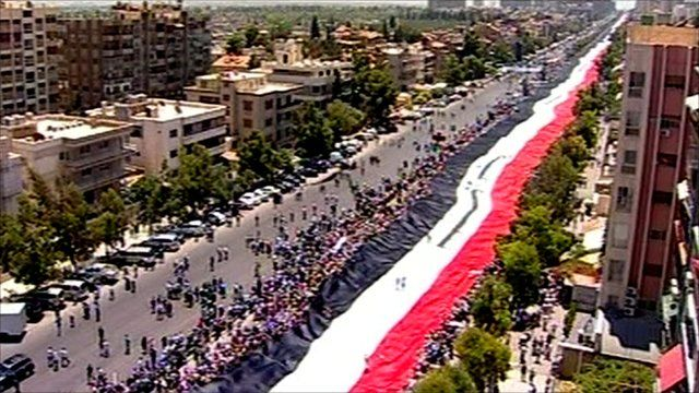 2000ft Syrian flag being held up by supporters of President Assad