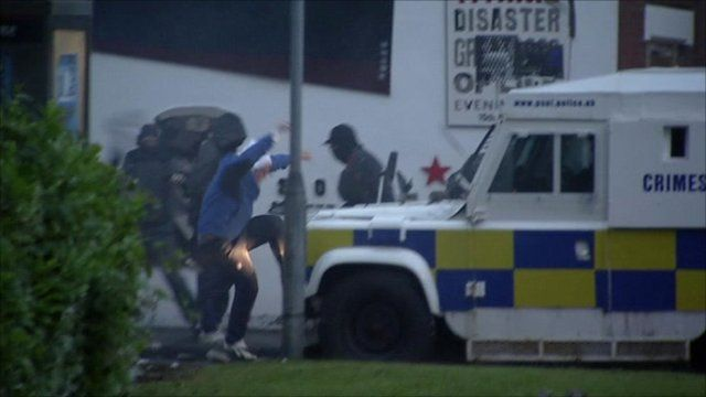 Young men attacking police vehicle in Belfast