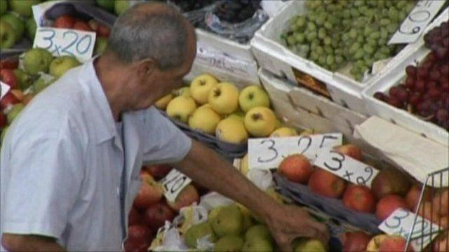 Man at greengrocer's stall