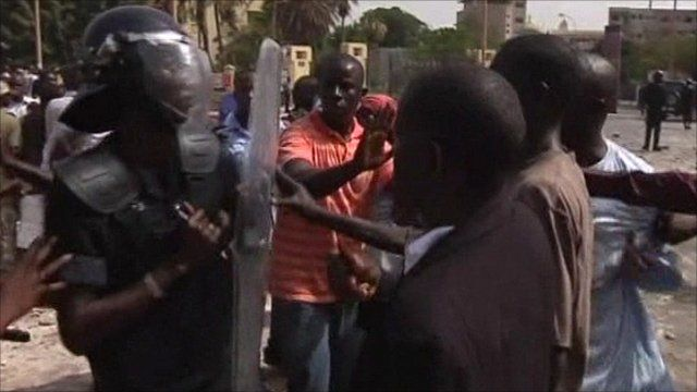 Riot police square up against protesters in Senegal