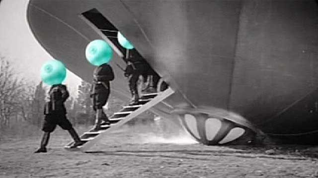 Aliens with green heads leave a flying saucer
